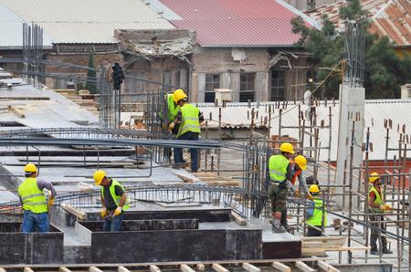 Arbeiter und Baumaschinen Standard-Bild - 33531187