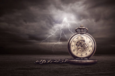 discharge time: Image of Time and lightning Stock Photo