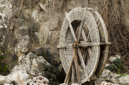 grist mill: Wooden wheel of an old water mill Stock Photo