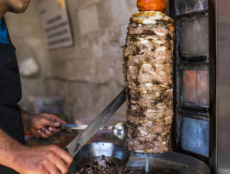 making a fire: Grilled Doner meat  on vertical spit