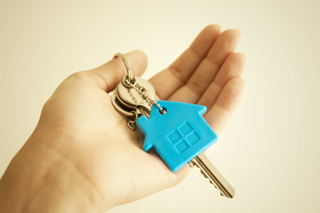 cottage house: House key in hand Stock Photo