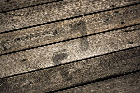 tarnish: step forward on dusty floor Stock Photo