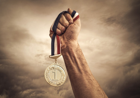 victory sign: leadership concept on clouds background.