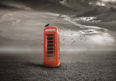 retro phone: traditional red telephone booth or public payphone