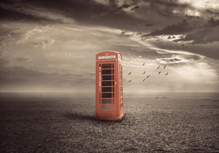 telephone booth: traditional red telephone booth or public payphone