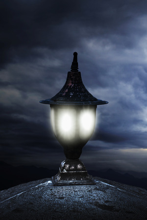 evening glow: Old fashioned street light at night
