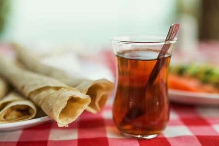 turkish bread: Typical Turkish breakfast with pitta  and black tea