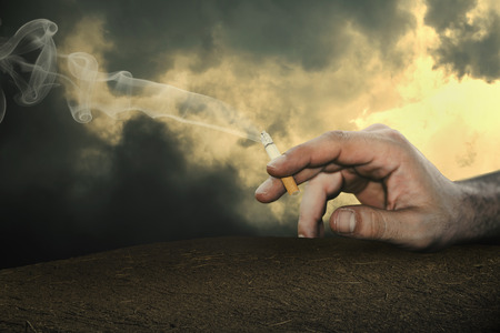 health risk: thr cigarette is in the hand of man.