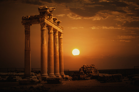 greek columns: Temple of Apollo on Sunset Stock Photo
