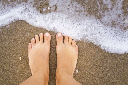 painted toenails: waiting for wave Stock Photo