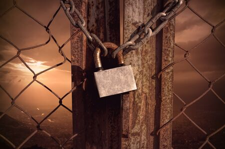 rusty fence: lock key with shackles on rusty fence Stock Photo