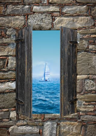 threw: View of a sailing boat threw a window Stock Photo