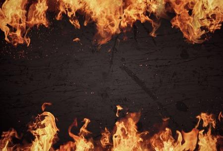 sizzling: Blazing flames over dark background