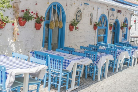 taverna: Cafe tables and chairs outside, Stock Photo