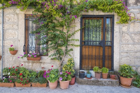 Old House with great flower decoration Stock Photo