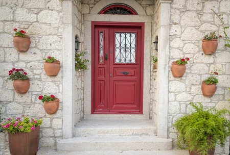 old doors: Old House with great flower decoration Stock Photo