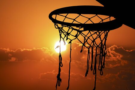 Basketball hoop outdoor in the sunset silhouette