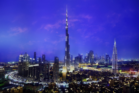 tower: skyscrapers in Dubai and blue sky at night Stock Photo
