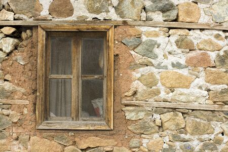 old barn: old window in an ancient brick wall in an abandoned farm barn,