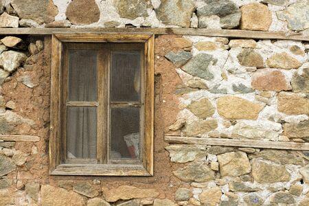 barns: old window in an ancient brick wall in an abandoned farm barn,