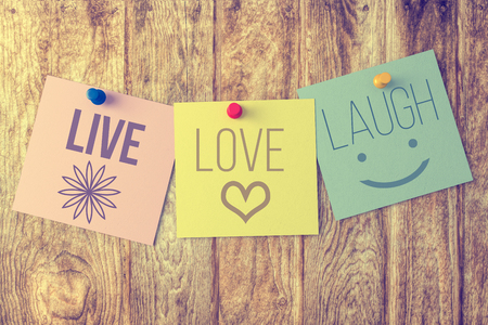 love words: Live laugh love on wooden background