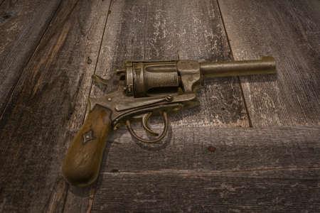 old desk: old ancient shotgun on the desk