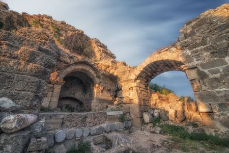 Road and ruins in Side, Turkey at sunset - archeology background Imagens