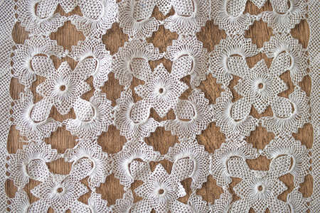 fabric pattern: pattern of  lace fabric against wooden background