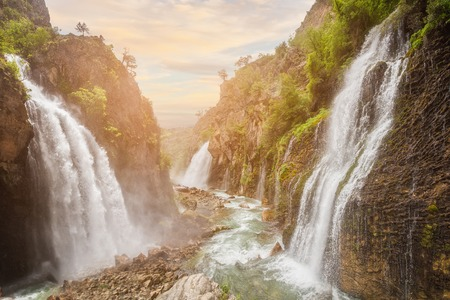 waterfall with sky: waterfall in mountain forest under great sky. Stock Photo