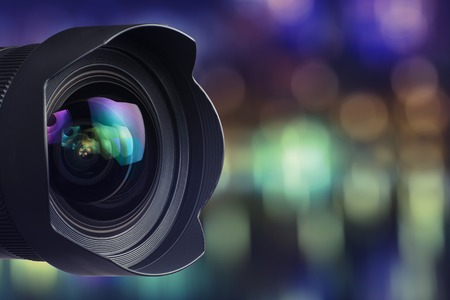 camera: Camera Lens with bokeh Background Stock Photo