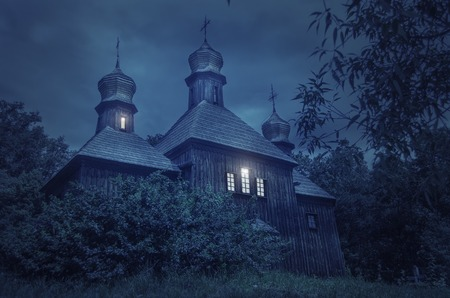 hallowmas: Old European church in a full moon night Stock Photo