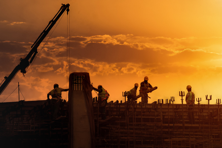 Construction site at sunset Imagens