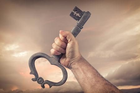 achieve: Key in human hand. Struggle and success