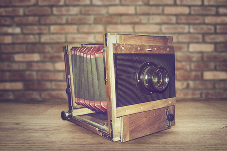 folding camera: Antique Old photo Camera on wooden table