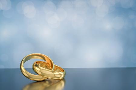 anillos boda: Par de oro anillos de boda en el fondo de bokeh, 3d Foto de archivo