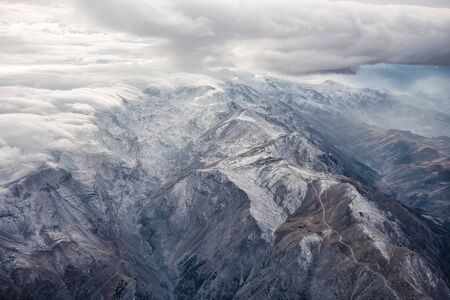 snow covered mountains: A snow covered Mountains with Clouds