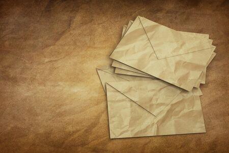 sobres de carta: Old Letter envelopes for mail postage on old Paper Foto de archivo