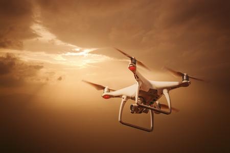 maneuvering: drone pilotage at sunset Stock Photo