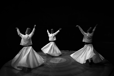 Black and White Dervishes twirling Stock Photo