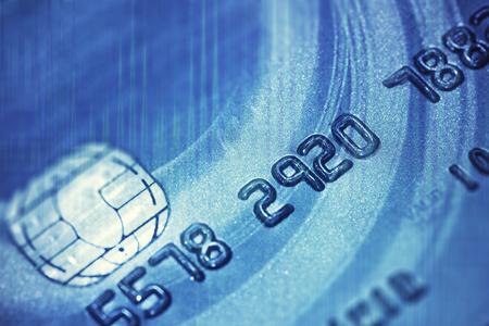 bankcard: Closeup image of blue credit card.