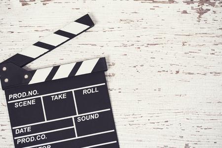 screenwriter: Screenwriter desktop with movie clapper board wooden background top view Stock Photo
