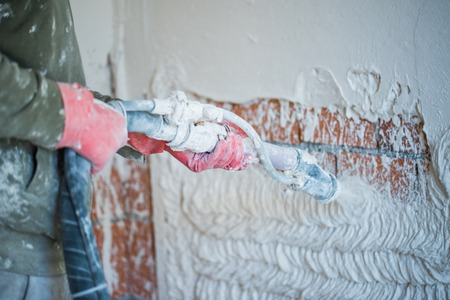 Plastering with a plastering pump Stock fotó