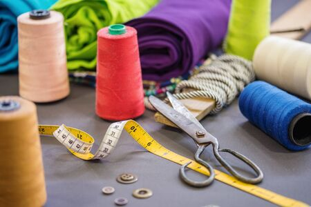 Sewing accessories on fabric background.Textile concept. Stockfoto