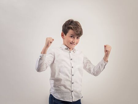 Portrait caucasian boy on grey background,Strong,Proud Stock Photo
