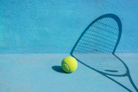 Tennis ball and racket on blue court.Sport Concept Stock Photo