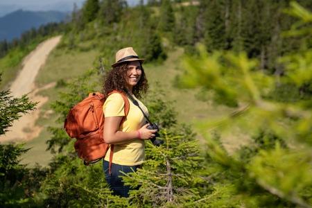 Young tourist woman taking a photo of landscape Banco de Imagens