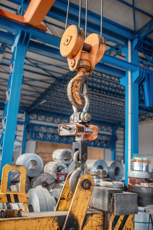 Heavy weighing machine in a factory for measuring products.
