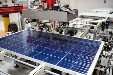 Manufacturing of solar panel system in factory.Industry concept. 版權商用圖片