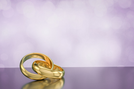 couple of gold wedding rings on bokeh background,3d rendering Stock Photo