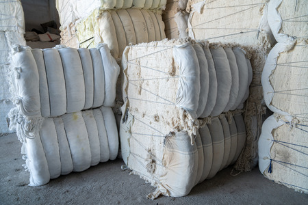 Interior of a storehouse .Stacked waste textile scraps In Bales